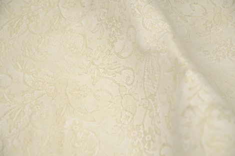 Cow leather with floral lace texture, dirty white