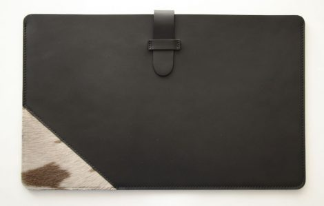 Leather laptop case decorated with fur